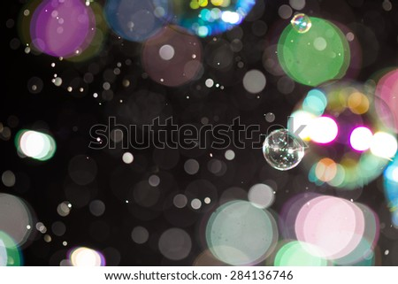 Blur Abstract colorful soap bubbles wallpaper isolated on black background - stock photo