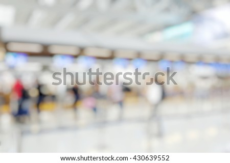 Blur abstract light background bokeh of Terminal Departure Check-in at airport. Burry view of check in counter row with passengers travelling by plane at air port. Blurred image backpacker at terminal - stock photo