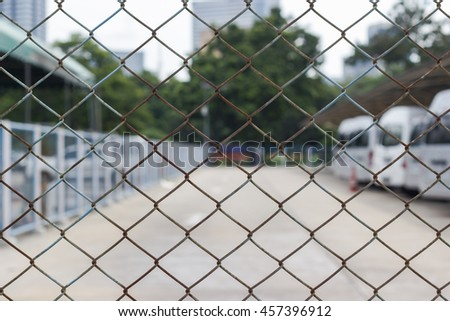 blur and soft focus steel net with car park  Be left outdoors - Bangkok Thailand