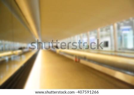 Blur background : A moving escalator - stock photo