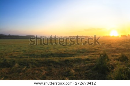 blur background .  autumn landscape with sunrise and fog   - stock photo