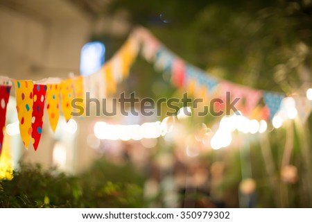 Blur background colorful triangular flags of decorated celebrate outdoor party, vintage tone. - stock photo