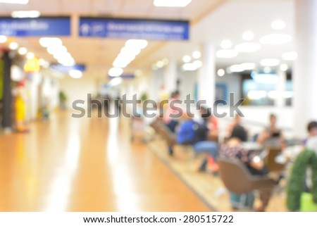 blur background futuristic Chiang Mai Airport interior people in motion blur - stock photo
