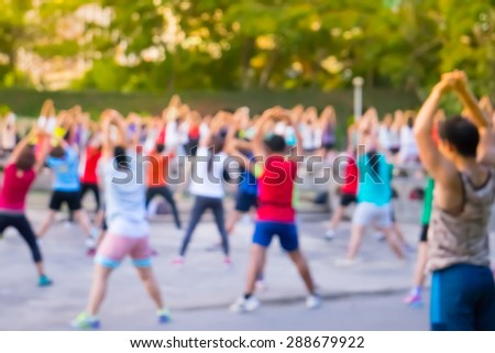 Blur background group man and women  dancing a fitness dance or aerobics in an old park  - stock photo