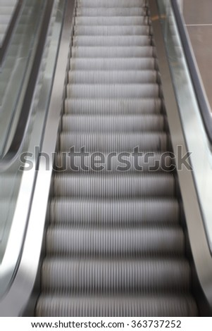 blur background of escalator in the building - stock photo