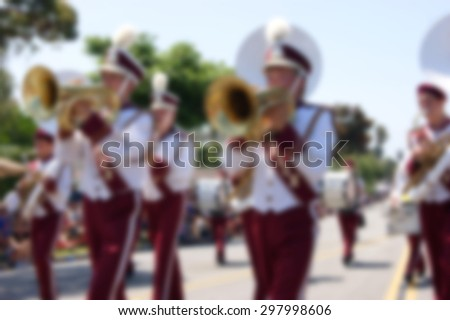 blur background of marching band in parade - stock photo