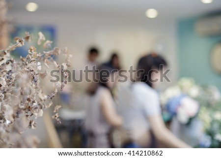 blur background of people arranging flowers