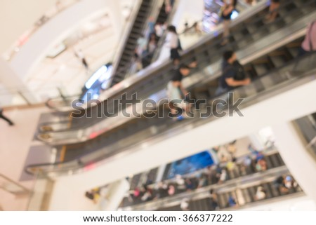 blur background of people with escalator interior shopping center - stock photo