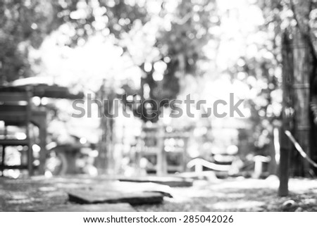 Blur background : Outdoor cafe in garden with wood table with boekh light ,Black and white filter. - stock photo