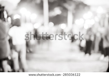 Blur background :Outdoor night market fair with bokeh light, black and white filter. - stock photo