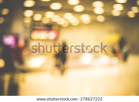 Blur background : passenger airplane waiting for bag at Baggage Claim with bokeh light. - stock photo
