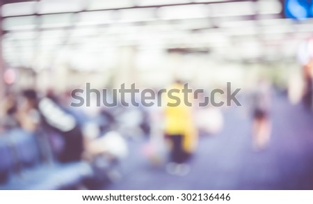 Blur background : Passenger waiting for flight at airport gate blur background with bokeh light. - stock photo