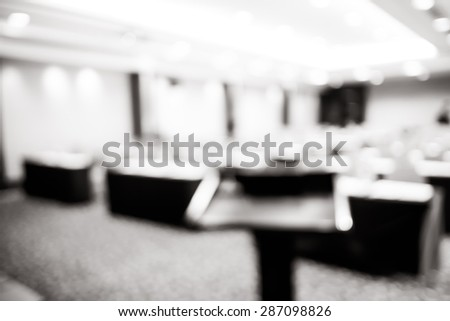 blur background, podium at seminar event room with bokeh light background,Business concept,black and white filter - stock photo