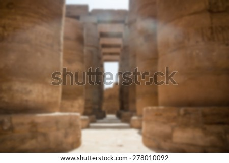 blur background with bokeh. Ancient Egyptian Columns.Temple of Amun Ra the Sun God (columned hall of the temple),Egypt - stock photo