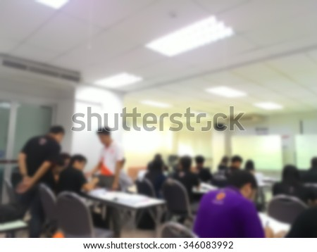 Blur behind student or collegian study, lecture in classroom with notebook and screen projector in bachelor or master or Ph.D. degree in university, college or business seminar, business meeting
