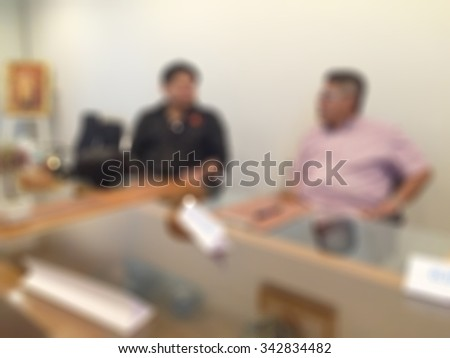 blur blurred businessmen discussion meeting and working with financial and documents in modern office - stock photo