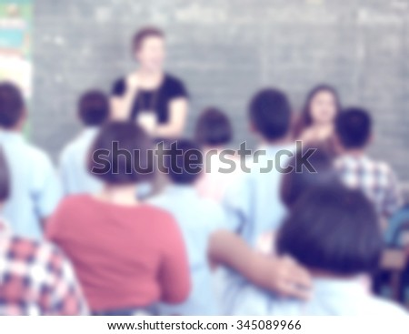 blur blurred English classroom with young male and female students - stock photo