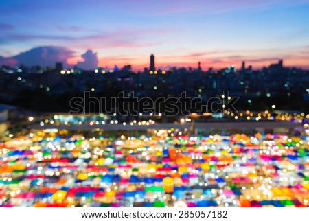 Blur bokeh of Flea market aerial view with beautiful sky after sunset - stock photo