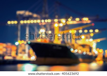 Blur bokeh of harbor with large ship and crane at night