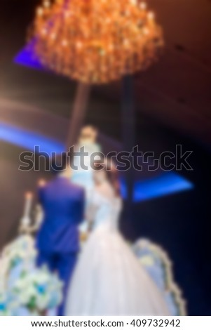 Blur Bride and Groom Cutting The Wedding Cake in The Big Ceremony Event Room used as Template - stock photo