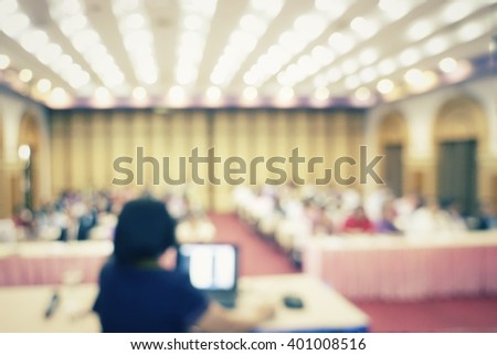 Blur business people in convention room with presentation equipments - stock photo