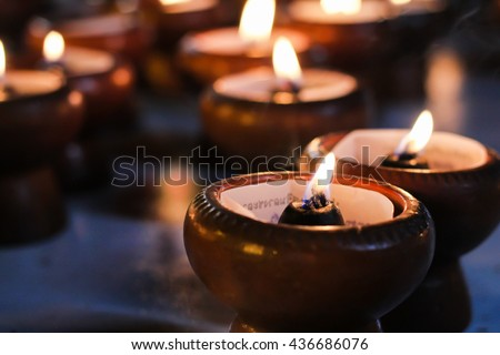 Blur candles in the dark background. - stock photo