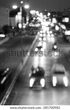 blur cars traffic on urban street black and white  - stock photo