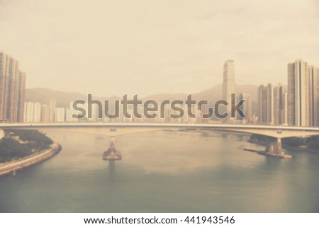 blur city landscape - abstract motion blurred background of Hong Kong high rises and river port - stock photo
