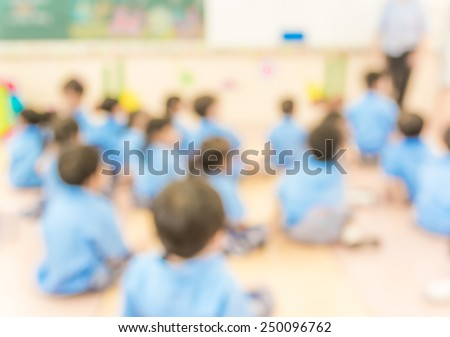 blur classroom  with teacher and kids in uniform - stock photo