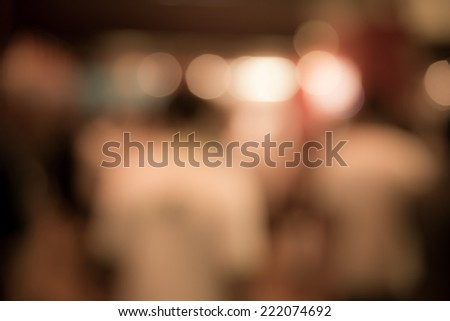 Blur crowded people with light in urban lifestyle vintage tone - stock photo