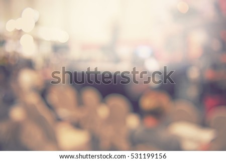 blur event seminar with activity on stage - blurred background - bokeh light vintage tone - business concept