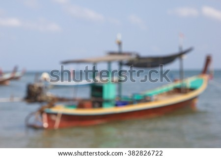 Blur fisherman boat on beach with blue sky - stock photo