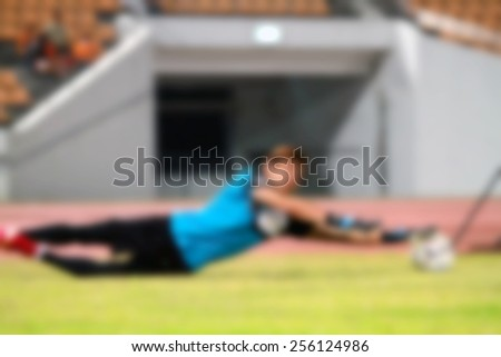 blur Goalkeeper with ball in action and warm up for background - stock photo