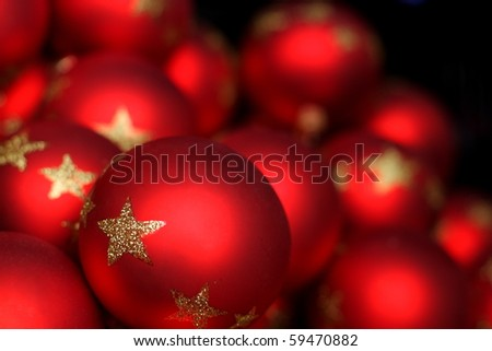 Blur illuminated red  christmas glass balls in a dark space - stock photo