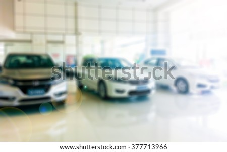 Blur image car show room use for background. - stock photo