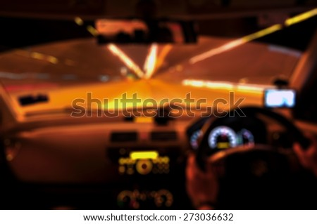 Blur image from inside a car traveling at night in the city