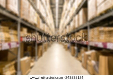 Blur image of a warehouse with multi layer shelves - stock photo