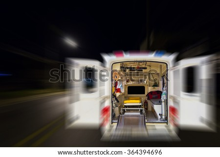 Blur image of ambulance on the road use for background. - stock photo