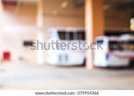 blur image of buses parking on building  - stock photo