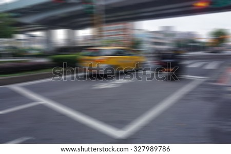 Blur image of busy traffic at taipei town - stock photo
