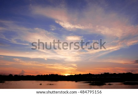 Blur image of colorful sunset with river
