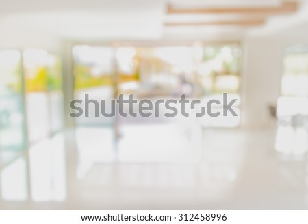blur image of hospital office room with table and chairs for background usage. - stock photo