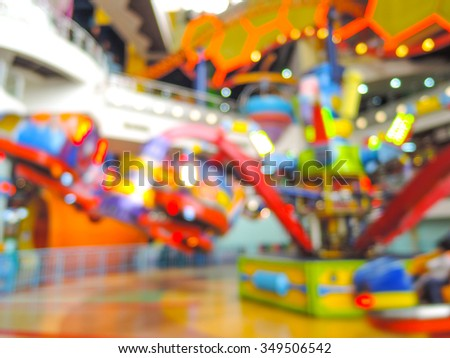 Blur image of indoor theme park with bokeh - stock photo