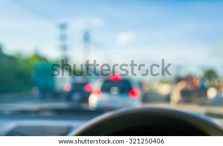 blur image of inside cars with bokeh on day time. - stock photo