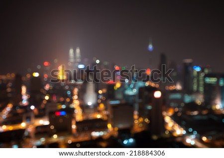Blur image of Kuala Lumpur at hazy night - stock photo