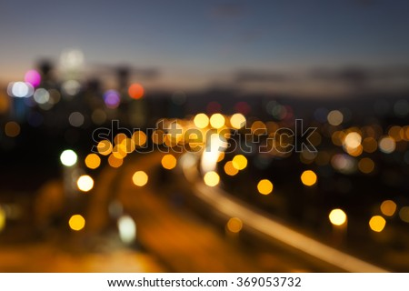 Blur image of Kuala Lumpur city skyline with circle bokeh - stock photo