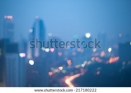 Blur image of Kuala Lumpur with heart bokeh - stock photo