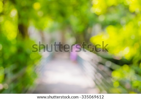 blur image of Long empty corridor with open space to the green garden for background usage . - stock photo