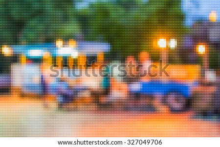 blur image of night festival on street background with bokeh .(Mosaic pattern effect image)