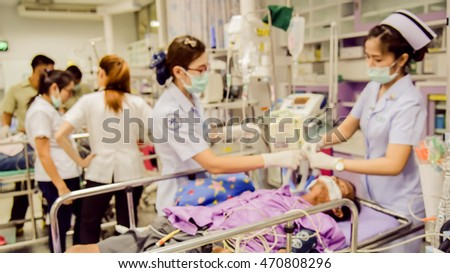 Blur image of nurs giving nursing care to patient in hospital